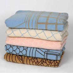 Beautiful blankets. I'd love a stack of them that somehow magically remained free of loitering cats.