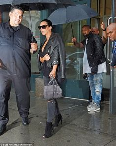 Bombshell: The mother-of-one highlighted her curvy figure in fitted trousers and accentuated her long legs with peeptoe black booties