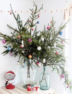 Budget-Friendly Decorating Ideas for Your Most Stylish Christmas via Create your own Christmas tree in a bottle! Christmas Branches, Unique Christmas Trees, Alternative Christmas Tree, Noel Christmas, Christmas Wreaths, Christmas Crafts, Beautiful Christmas, Simple Christmas, Tabletop Christmas Tree