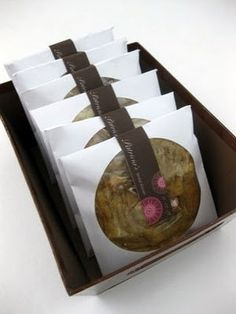 used CD envelopes for cookies along with a personalized sticker. Such a great idea!