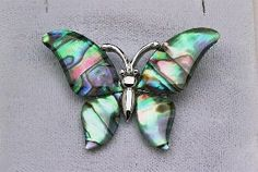 A colorful abalone shell butterfly, set in a shining silver-tone pin, will shimmer attractively on your collar. Butterfly Pin, Abalone Shell, Shells, Conch Shells, Conchas De Mar, Sea Shells, Seashells, Shell
