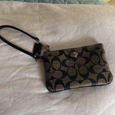 Authentic Coach wristley. This authentic Coach wristlet has only been used twice. Excellent condition. Black with grey. Coach Bags
