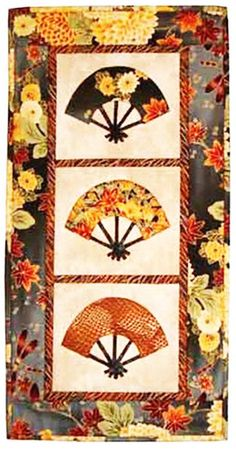 "Three graceful fans highlight oriental print fabrics. This easy to make 12 1/5"" x 24 1/2"" wall hanging uses fusible appliqué. You could use individual blocks for small wall hangings or even placemats."
