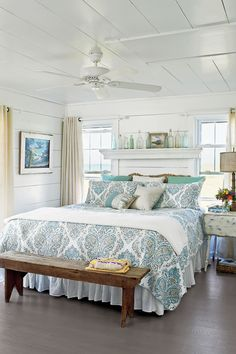 "A blue-and-green patterned duvet and accent pillows add a lively touch to the master bedroom in this Bald Head Island, North Carolina, cottage. ""I kept the decor simple but comfortable,"" says designer and homeowner Tiffany McWhorter. ""I didn't want any on"