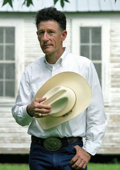 Lyle Lovett, singer/songwriter, born in Klein, Texas. But more importantly, check out that Aggie Ring! Whoop!