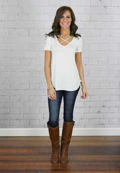 We just love these tops. They are casual and cute with the criss cross detail. Pair with jeans or leggings for a go anywhere style!