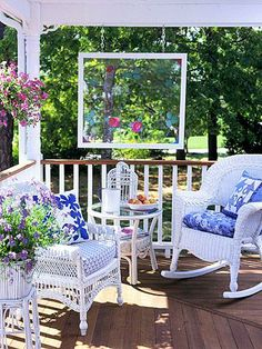 "❤ Get cozy- Just a couple of chairs and a side table can transform a corner of your porch into a charming sitting area. Choose neutral furniture, providing pops of color with cushions and flowers. Then let nature do the rest. A creative hanging ""window"" frames the view."