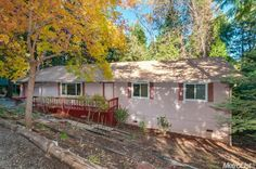 4595 Wandering Way, Camino, CA 95709 — Situated in high pines and cedars. Single story, Cute 3 bedroom/2 bath. 1 car garage. 1 acre.  1552 Sq feet, Built: 1985, Wood stove, dual pane windows installed 7 yrs ago. Kitchen remodeled and new floors installed 6 years ago. Raised beds tier down in front yard, new water-heater just installed, Separate laundry room in garage.  Private deck in back. Interior just painted.