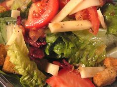 Hot Bacon Dressing over fresh crisp greens, provolone cheese, and croutons.