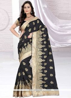 Elegance and honourable come together in this beautiful drape. Be the center of attraction with this black art silk designer saree. Beautified and stylized with embroidered, lace, resham and zari  wor...