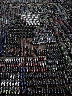 Thousands of new motorcycles are parked at the Tanjung Priok port in Jakarta at August, 5, waiting for ships to transport them to Indonesia's provinces. (Supri/Reuters) #vehicular