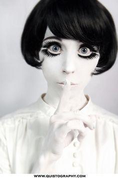 Big eyes, white face