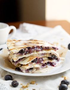 Creamy brie cheese, walnuts and fresh blueberries come together to make this crazy good Blueberry Brie Walnut Quesadilla. Perfect for breakfast or dessert!