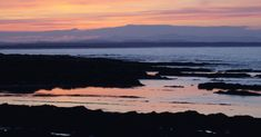 Sunset light reflected in the sea in St Andrews. 6 June 13.