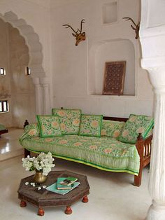 Indian style living room, love the Deewan and coffee table