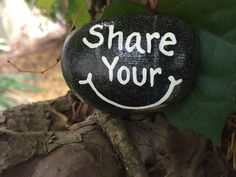 Share Your Smile. Hand painted rock by Caroline. The Kindness Rocks Project