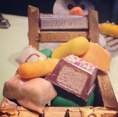 #FestiveBreakTimeTips. No2: Assemble your presents in a KITKAT sled decorated with marzipan and edible paint. Who is hiding behind the sled?