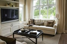 Position your couch under an oversized window to allow the sunlight and outdoor scene be the focal point of an otherwise neutral room.  - GoodHousekeeping.com