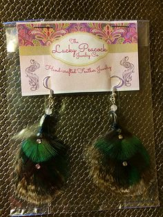Shop and save with VarageSale, your free virtual garage sale app. Feather Jewelry, Feather Earrings, Hill Park, Beacon Hill, Windy Day, Earring Backs, Peacocks, Beautiful Hands, Cruelty Free