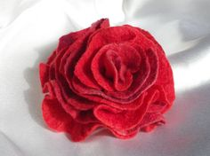 Welcome and thank you for visiting my shop!  Ive made this beautiful rose like flower brooch with wet felting technic using Australian merino and mulberry silk fibres. Clip it to a plain jacket, or bag, or hat, or scarf, to add a slash of quick colour, and you have an instant make over