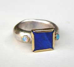 Opal ring and lapis lazuli ring gold ring silver ring by OritNaar, via Etsy.