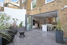 Kitchen extension ideas that spill into the outdoors bi fold doors