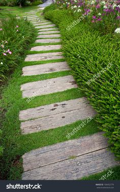 Find Bending Garden Stone Path stock images in HD and millions of other royalty-free stock photos, illustrations and vectors in the Shutterstock collection. Thousands of new, high-quality pictures added every day. Backyard Walkway, Front Yard Landscaping, Walkway Ideas, Garden Yard Ideas, Garden Paths, Back Gardens, Outdoor Gardens, Sloped Garden, Garden Stones