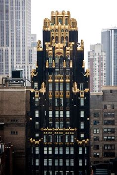 The American Radiator Building in NYC: Black brick on the frontage of the building (symbolizing coal) was selected to give an idea of solidity and to give the building a solid mass. Other parts of the facade were covered in gold bricks (symbolizing fire), and the entry was decorated with marble and black mirrors. Built in 1924.
