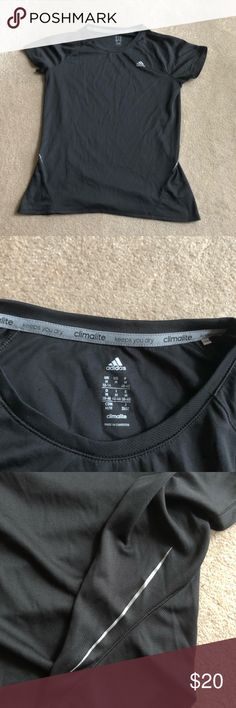 Adidas Dry Fit Shirt Never used. Bough for soccer but I got hurt so never used this shirt. Great for any exercise. Has a silver line on the sides adidas Tops Tees - Short Sleeve