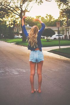 Summer. I don't know why but I love this. Her waves, tan legs, open back shirt, & cut offs.