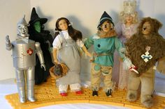 Dorothy has a basket with Toto (Toto can be removed from the basket) The Wicked Witch of the West has her broom.