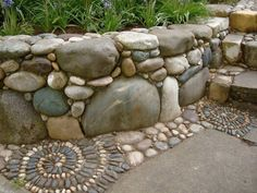 Wonderful retaining wall with mosaic pebble edging. Replace square concrete with natural flagstone.