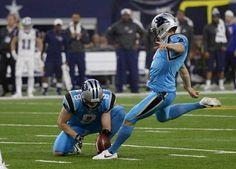 Carolina Panthers' Graham Gano (9) follows through on a field goal, as Brad Nortman (8) holds, against the Dallas Cowboys in the first half at AT&T Stadium on Thursday, November 26, 2015. The Panthers won 33-14 and improved to 11-0.