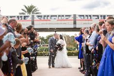 Disney Fairy Tale Wedding ceremony exit with bubbles and the monorail in the background at Disney's Wedding Pavilion