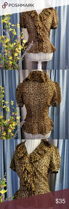 🌻🌺🌻RALPHA LAUREN 100% SILK CHEETAH PRINT BLOUSE SIZE:small   BRAND:Ralph Lauren   CONDITION:like new, no flaws    COLOR:tan/brown/black (color best seen in last photo)  Button down in front   🌟POSH AMBASSADOR, BUY WITH CONFIDENCE!   🌟CHECK OUT MY OTHER ITEMS TO BUNDLE AND SAVE ON SHIPPING!   🌟OFFERS WELCOME!   🌟FAST SHIPPING! Ralph Lauren Tops