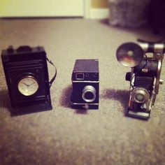 Sweet deals on vintage cameras that I got at Winners Home Sense the other day. I just love them! The camera on the far left has a clock in the lens. Neato eh? I love love love them!