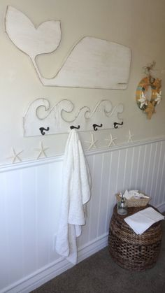 This just gave me a great idea of how to top the wainscotting in a room. Wooden Beach House Wave by MeetMeByeTheSea