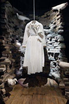 """BARNEY'S, New York, """"The Maison Margiela Windows"""", (Reinforcing the idea of juxtaposition, the all-white coat stands in stark relief to the rainbow-hued pigeons that fill the other half of this last window), pinned by Ton van der Veer"""