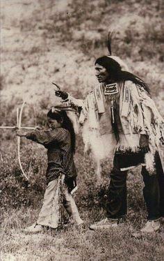 Kicking Bear Sioux Indian Teaches Son Bow & Arrow, Native American