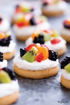 This Mini Fruit Pizza recipe is easy to make with a shortbread cookie crust, cream cheese and Cool Whip frosting, and sliced fruit. It's the perfect summer dessert for everything from a bridal shower to a backyard cookout.