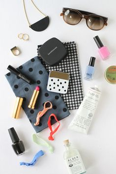 Love this product styling for the what's in your bag? Beauty products, jewelry, and our anthro back up mobile charger!