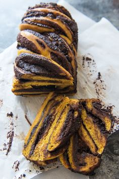 Sweet, spiced pumpkin yeast bread meets rich, dark chocolate in this twist on the classic babka. This gorgeous fall pumpkin chocolate babka bread is as delicious to eat as it is fun to make!