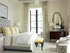 subtle yellow and gray bedroom, lots of white