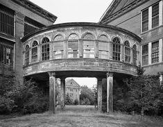 Christopher Payne does a beautiful job of capturing the haunting beauty of abandoned hospitals. This picture is called Bridge to Infirmary Ward, Taunton State Hospital, Massachusetts. Abandoned Buildings, Abandoned Asylums, Old Buildings, Abandoned Places, Spooky Places, Haunted Places, Abandoned Hospital, Haunted Hospital, Old Mansions
