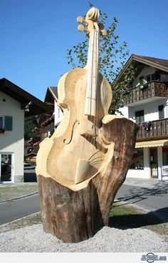Violin Wood Carving - as chainsaw wood carving that would be among my favourites. No. 1.