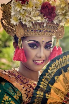 the Legong is a Balinese traditional dance, performed with beautiful and colorful costume. It is a refined dance form characterized by intricate finger movements, complicated footwork, and expressive gestures and facial expressions.