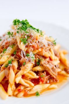 Pork Sugo with Strozzapreti - A simple slow cooked pork sugo with strozzapreti pasta (or other small pasta). The pork is braised in wine and tomatoes until it's tender enough to shred.