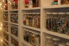 clear jars, on shallow shelves.  too deep and you'd lose things.