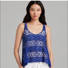 ⚡SALE⚡️ NEW $88 lace crochet tank top 2 What/who is XCVI? It is a high-end brand sold at luxury department stores, such as Neiman Marcus, Saks, and Bloomingdale's. This tank is brand NEW with tags (NWT) and retails for $88. The color is royal blue & is more of a thick crochet material rather than lace. It is a size 2 & would fit a size XS, small, or smaller medium - it is loose-fitting on me & I wear a size XS/0. XCVI Tops Tank Tops