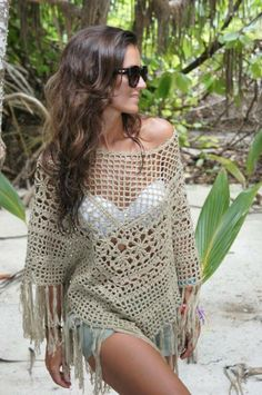 Beautiful crocheted bathing suit cover up. http://nuevatemporada.blogs.elle.es/2013/09/02/crochet-vs-ethnic-the-call-of-the-jungle/